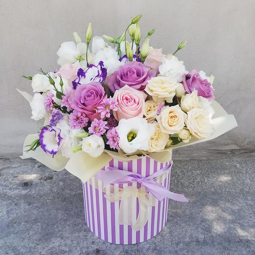 Box of roses and eustoma in delicate shades