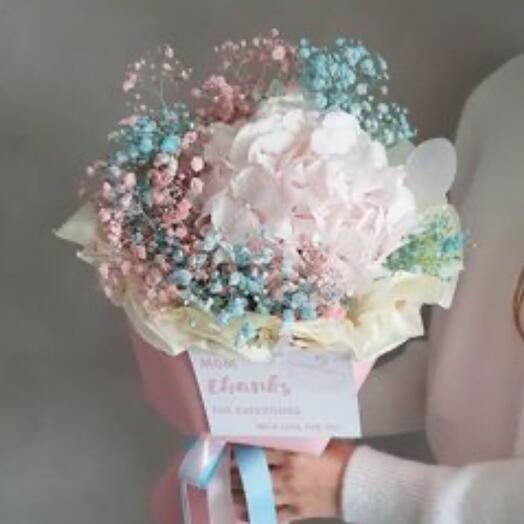 Delicate hydrangea with balls of blue and pink gypsophila