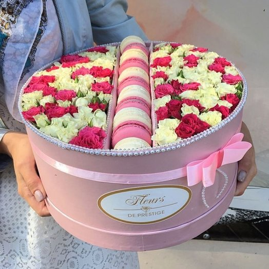 A box of macaroons and a rose