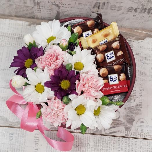 Arrangement of flowers and chocolate