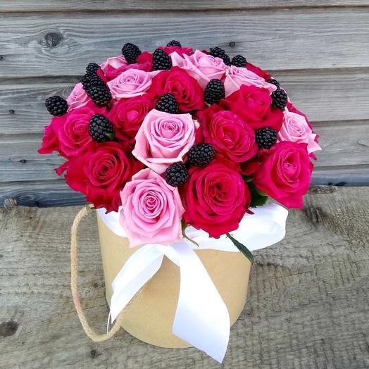 Arrangement of roses and berries