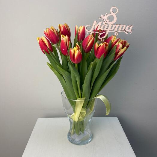 15 tulips in a vase
