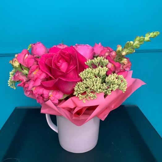 Flower arrangement in a glass