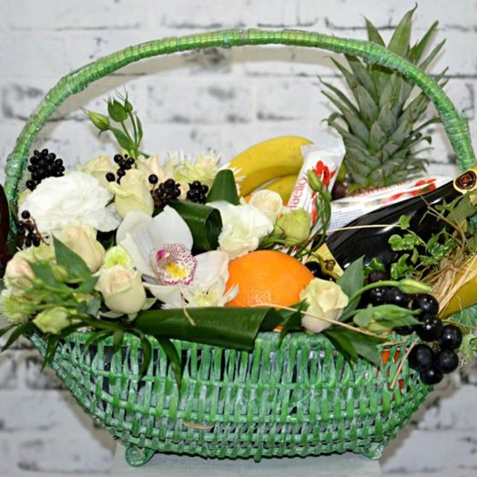 Basket with flowers and fruit