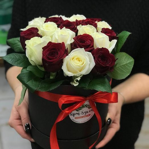 21 white and red roses in a box