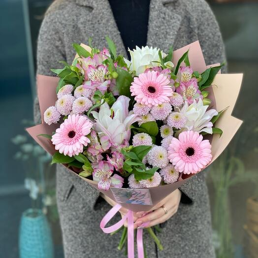A delicate bouquet with a peony-shaped lily and gerberas