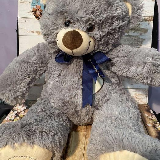 grey bear with a bow