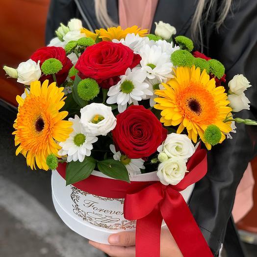 Arrangement in a box of Gerberas, roses and chrysanthemums
