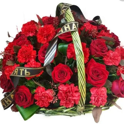 Funeral basket of red roses and red carnations