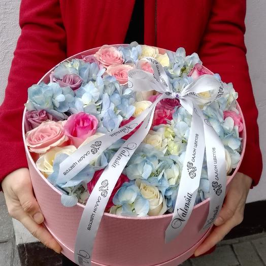 Box with flowers in delicate shades