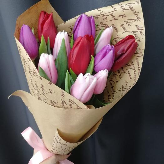 Bouquet of tulips in a craft package Hit March 8