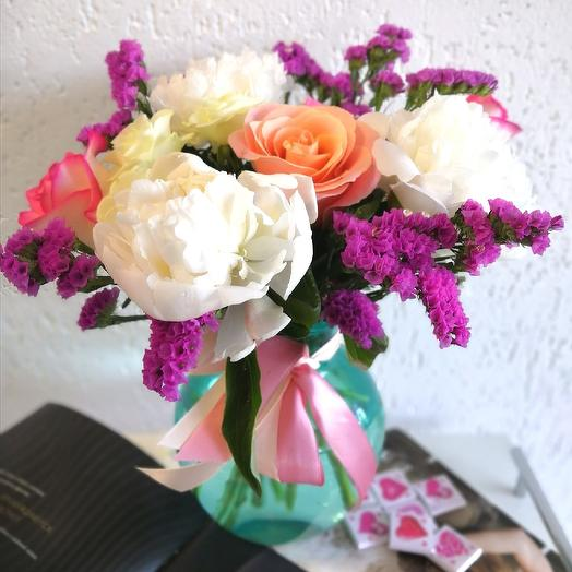 Bouquet with peonies in a vase