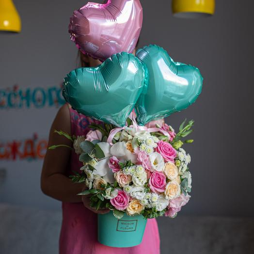 Tenderness or a floral arrangement with balloons