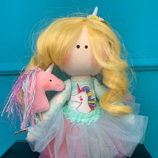 Author's doll with a unicorn