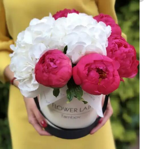 Coral peonies and white hydrangeas in a box