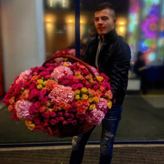 A huge basket of roses and hydrangeas