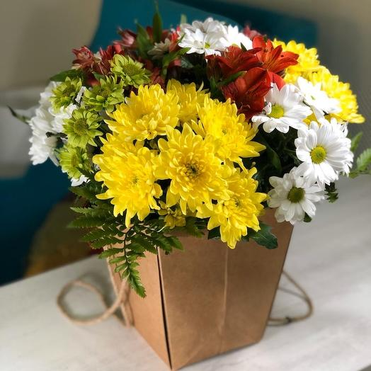 A bouquet of chrysanthemums in playm package