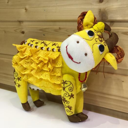 Корова желтая