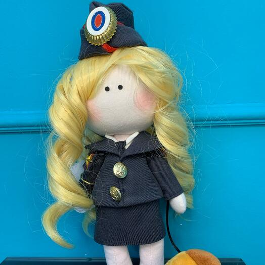 The author's doll is a policeman
