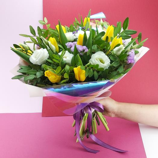 Yellow tulips with white eustoma.
