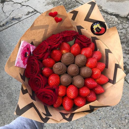 A bouquet of strawberries and roses