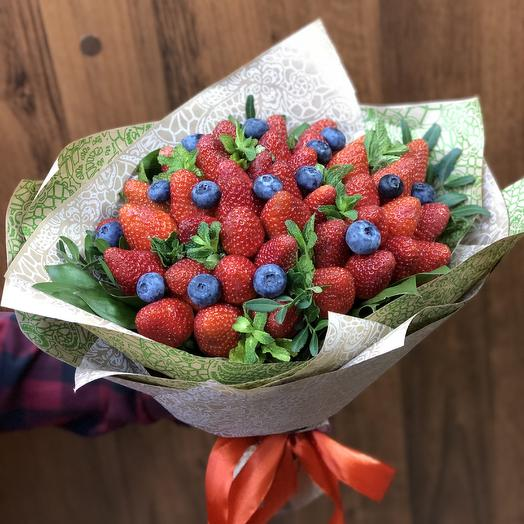 A bouquet of strawberries and blueberries
