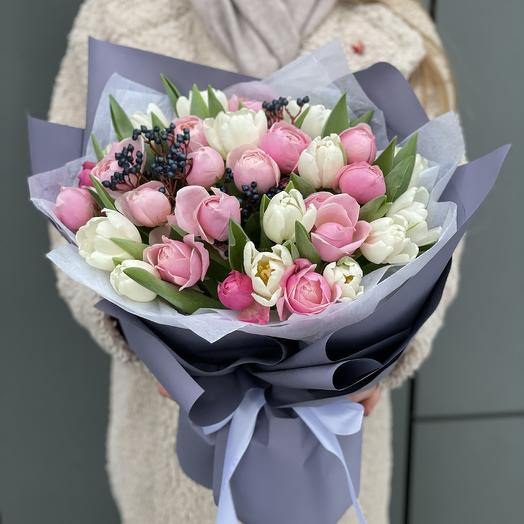 Delicate March bouquet of tulips, roses and viburnum