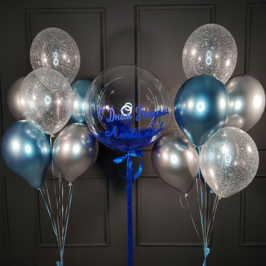 Композиция с баблом с синими перьями и двумя фонтанами из шаров
